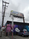 Legal Dockside Cannabis building with mural and billboard along Stock Photography