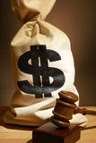 Legal Expenses. A bag of money and gavel represent many legal expenses Stock Image