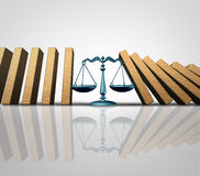 Legal Help. And lawyer services concept as a group of falling domino pieces being supported by a justice scale as a law aid and solving problems metaphor as a Stock Photo