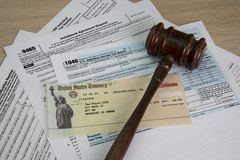 Legal help in Taxes. Tax time with tax forms and sinking and drowning in debt and need help filing so there is no audit. Individual Tax Return or Installment royalty free stock images