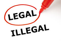 Legal or Illegal with Red Marker. Choosing Legal instead of Illegal. Legal selected with red marker Stock Photo