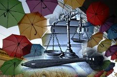 Legal insurance. Different colorful umbrellas and decorative scales of justice, concept of legal insurance Stock Photography
