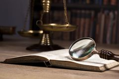 Legal investigation.scale of justice. Law. Judge`s office. Magnifying glass on law book.Scale of justice in the background Law and justice concept. Legal office Royalty Free Stock Photography