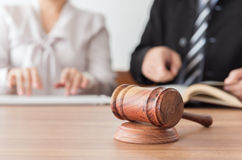 Legal. Judge gavel with lawyers having team meeting at law firm in background. Concepts of law,legal advice and services,online auction stock photos