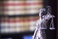 Legal justice statue in law firm office. Legal blind justice Themis metal statue with scales in chain in law firm offices photo Royalty Free Stock Photography
