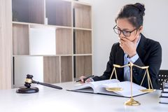 Legal law, advice and justice concept, Professional Female lawyers working on courtroom sitting at the table and signing papers w royalty free stock photo