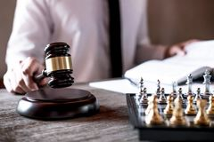 Legal law, advice and justice concept, Professional male lawyers working on courtroom sitting at the table and signing papers with royalty free stock photo