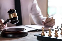 Legal law, advice and justice concept, Professional male lawyers working on courtroom sitting at the table and signing papers with stock photography