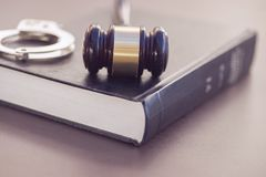 Legal law concept image. Gavel, book and handcuffs on desk stock images