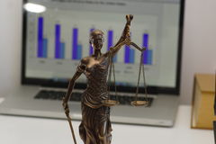 Legal law concept image. Gavel with computer screen background financial figures background stock image