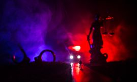 Legal law concept. Silhouette of handcuffs with The Statue of Justice on backside with the flashing red and blue police lights at. Legal law or crime concept stock photography