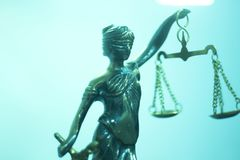 Legal justice law statue. Legal law firm bronze statue of the goddess themis with scales of justice in attorneys office royalty free stock photos