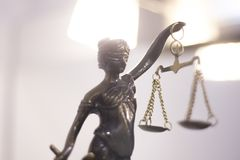 Legal justice law statue. Legal law firm bronze statue of the goddess themis with scales of justice in attorneys office royalty free stock image