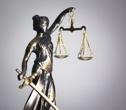 Legal law firm statue. Legal law firm bronze statue of the goddess themis with scales of justice in attorneys office stock images