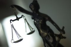 Legal law firm statue. Legal law firm bronze statue of the goddess themis with scales of justice in attorneys office Royalty Free Stock Photography