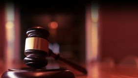 Legal law justice image. Gavel on desk top in court room with copy space stock photography