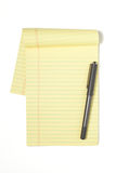 Legal Pad with pen. A Legal Pad Isolated on White with Pen Royalty Free Stock Photo