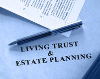 Legal series. Blue shaded image of living trust and estate planning document. A tax form is also included in the scene Stock Image