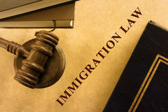 Legal series. Immigration law.  A judge's gavel and sounding block with immigration law handbooks Stock Image