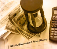 Legal series. Sepia shaded image of Wealth Preservation & Estate Planning - legal statement. Hourglass, calculator and hundred dollar bills on financial pages of Stock Image