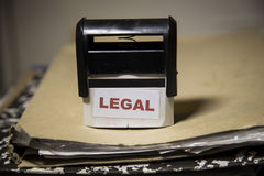 Legal stamp on a big folder of paperwork Royalty Free Stock Images