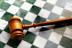 Legal strategy. Judges wooden gavel on a chess board Royalty Free Stock Photo