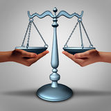 Legal Support. And lawyer advice concept as two hands holding a justice scale as a metaphor and law symbol for court services and contract advice Royalty Free Stock Photo