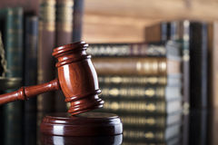 Legal system. Law and justice concept. Gavel of the jugde in the court library Royalty Free Stock Photography