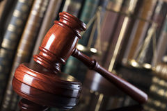 Legal system. Law and justice concept. Gavel of the jugde and scale of justice in the court library Stock Photography