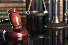 Legal system. Law and justice concept. Gavel of the jugde  and scale of justice in the court library Stock Images