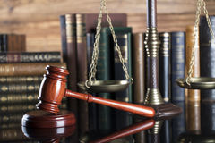 Legal system. Law and justice concept. Gavel of the jugde  and scale of justice in the court library Royalty Free Stock Photography