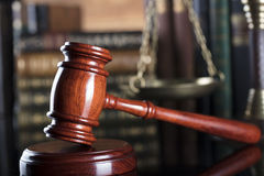 Legal system. Law and justice concept. Gavel of the jugde  and scale of justice in the court library Stock Photo