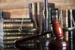 Legal system. Law and justice concept. Gavel of the jugde  and scale of justice in the court library Royalty Free Stock Image
