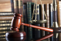 Legal system. Law and justice concept. Gavel of the jugde  and scale of justice in the court library Stock Photos