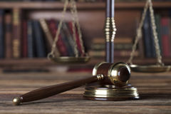 Legal system. Law and justice concept. Gavel of the jugde and scale of justice in the lawyer library Stock Photos