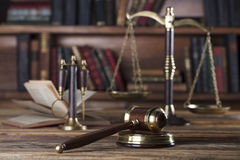 Legal system. Law and justice concept. Gavel of the jugde and scale of justice in the lawyer library Royalty Free Stock Photo