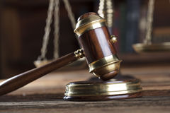 Legal system. Law and justice concept. Gavel of the jugde and scale of justice in the lawyer library Stock Images