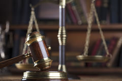 Legal system. Law and justice concept. Gavel of the jugde and scale of justice in the lawyer library Royalty Free Stock Image
