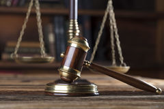 Legal system. Law and justice concept. Gavel of the jugde and scale of justice in the lawyer library Stock Photo