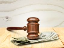 Legal system. Law finance currency human settlement gavel justice Stock Photo