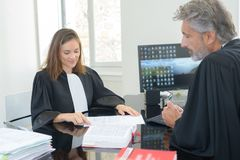 Legal workers consulting reference book. Legal royalty free stock images