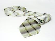 Legame di seta isolato verde sul Fotografie Stock