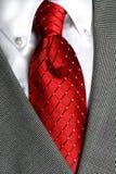 Legame rosso della camicia bianca Fotografie Stock