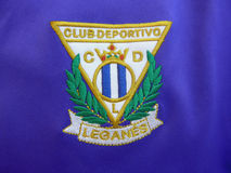 Leganes soccer club patch sewed in purple tshirt Royalty Free Stock Photography