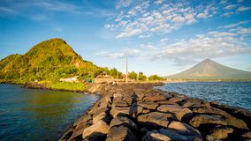 Legazpi City, Luzon, Philippines - Mount Mayon volcano looms over the city as daily life goes on. Legazpi City, Luzon, Philippines - Mount Mayon volcano looms stock images