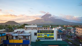 LEGAZPI, PHILIPPINES - JANUARY 5, 2018: - Mount Mayon volcano looms over the city as daily life goes on. royalty free stock photo
