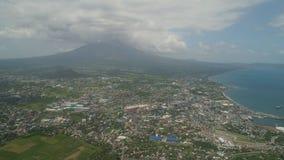 Legazpi city in the Pihilippines, Luzon. Aerial view city Legazpi in background Mayon volcano. Tropical landscape city near volcano on seashore, Philippines Stock Photo