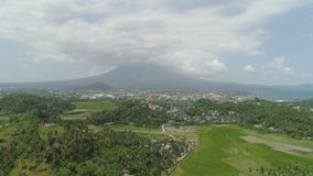 Legazpi city in the Pihilippines, Luzon. Aerial view city Legazpi in background Mayon volcano. Tropical landscape city near volcano on seashore, Philippines stock image