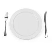Lege dinerplaat met mes en vork op wit Stock Foto's