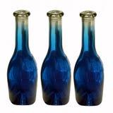 Lege donkerblauwe flessen Stock Afbeeldingen